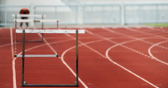 Running track with hurdles