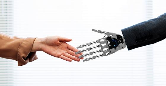 Human hand reach to meet a robot hand