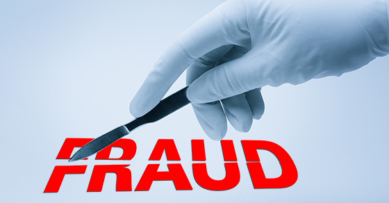 The word FRAUD being carved by surgical knife
