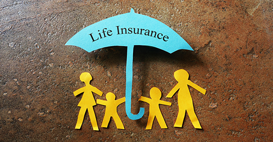 Paper cutout of family under an umbrella that reads LIFE INSURANCE