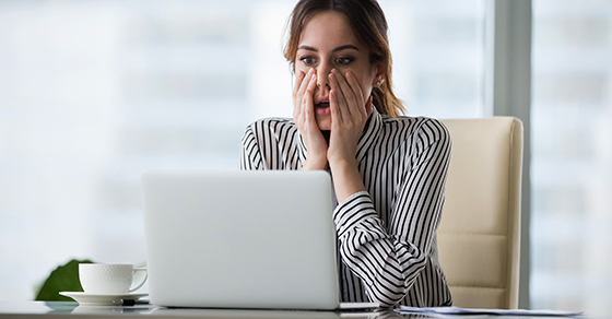 Woman worried looking at laptop