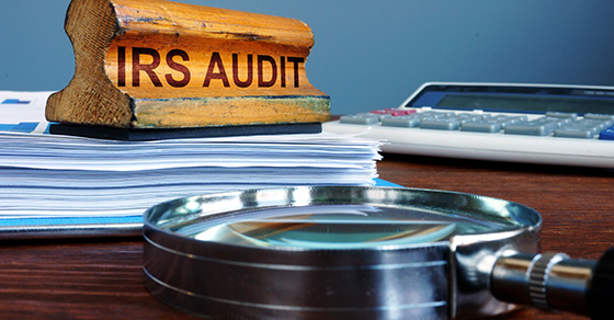 Rubber stamp IRS AUDIT on a desk