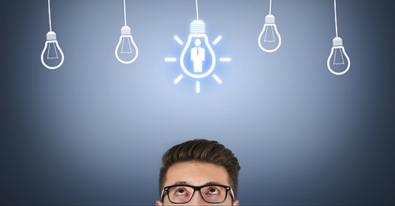 Man's head with light bulb above it