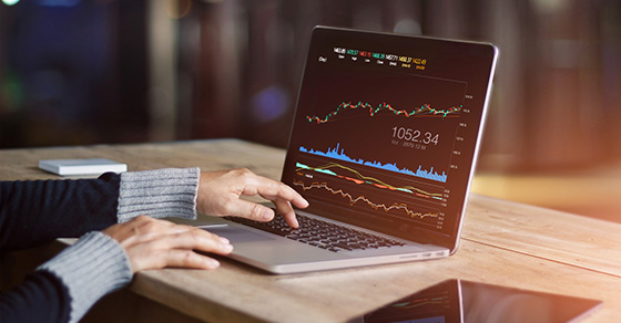 Laptop with stock market chart